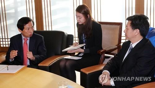 韩联社新华社高层会面共商合作事宜