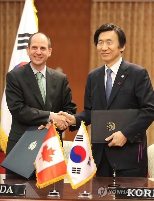 韩国加拿大签科技创新合作协定