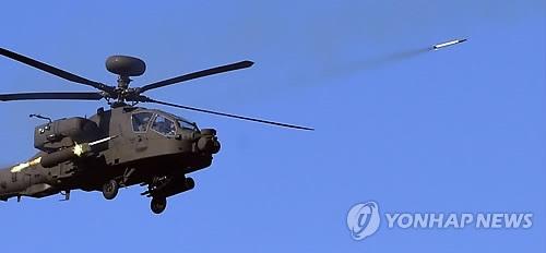 韩军首次进行阿帕奇直升机实射演习