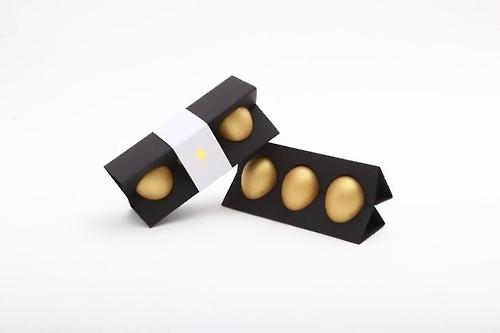 资料图片:新世界百货将在春节期间为中国客户举行抽金蛋活动。(韩联社)