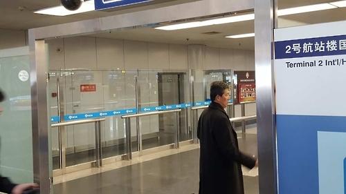 """朝鲜赴马""""收尸""""代表团经北京返回平壤"""
