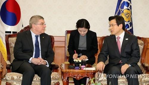 韩代总统会见奥委会主席立志办好平昌冬奥