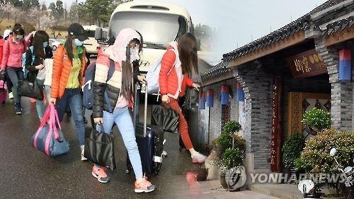 驻华朝鲜餐厅女员工集体弃朝投韩。(韩联社)