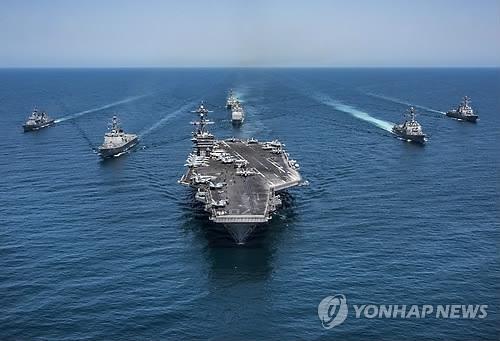 """图为正在参加韩美联合演习的""""卡尔·文森""""号航空母舰。(韩联社/欧新社/美国海军提供)"""