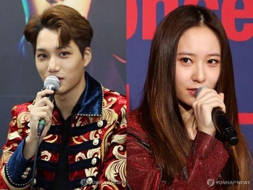 资料图片:EXO成员KAI(左)和f(x)成员Krystal(韩联社)