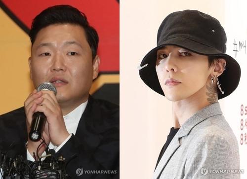 PSY(左)和G-DRAGON(韩联社)
