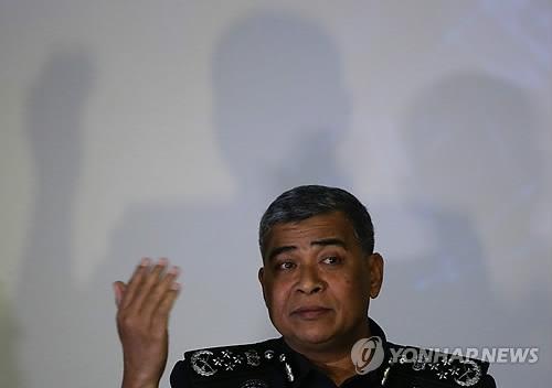 资料图片:2月22日,马来西亚警察总长哈立德·阿布·巴卡尔举行记者会,介绍金正男遇害案相关情况。(韩联社/欧新社)