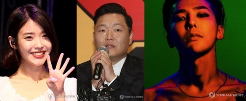 左起为IU、鸟叔PSY、G-DRAGON。(韩联社/YG提供)