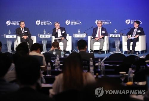 6月29日,在首尔市中区乐天酒店,韩联社与统一部举办韩半岛统一研讨会的专题辩论会。(韩联社)