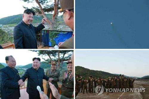 """上月朝鲜成功试射""""火星-12""""后,金正恩与在场军人庆祝。图片仅限韩国国内使用,严禁转载复制(韩联社/朝中社)"""