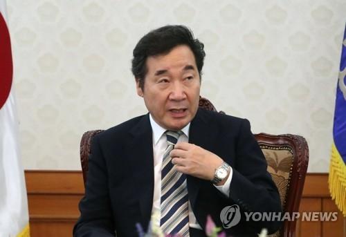 8月20日,在韩国中央政府首尔办公楼,国务总理李洛渊接受韩联社记者专访。(韩联社)