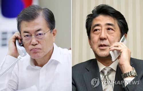 资料图片:韩国总统文在寅(左)和日本首相安倍晋三(韩联社)