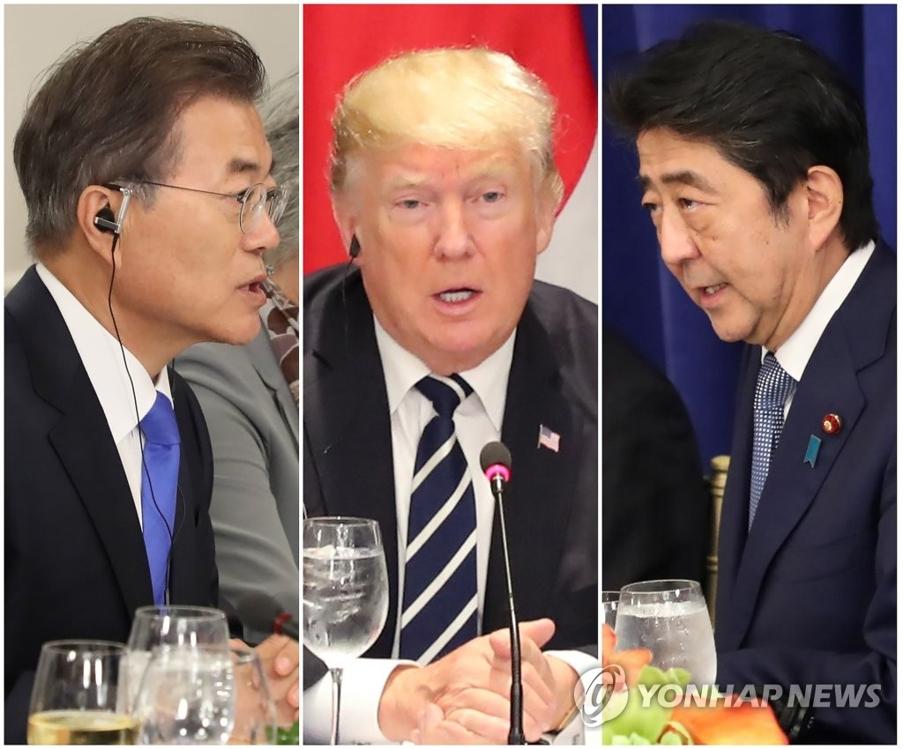 当地时间9月21日,在美国纽约,文在寅(左起)、特朗普和安倍晋三在会谈上进行开场发言。(韩联社)