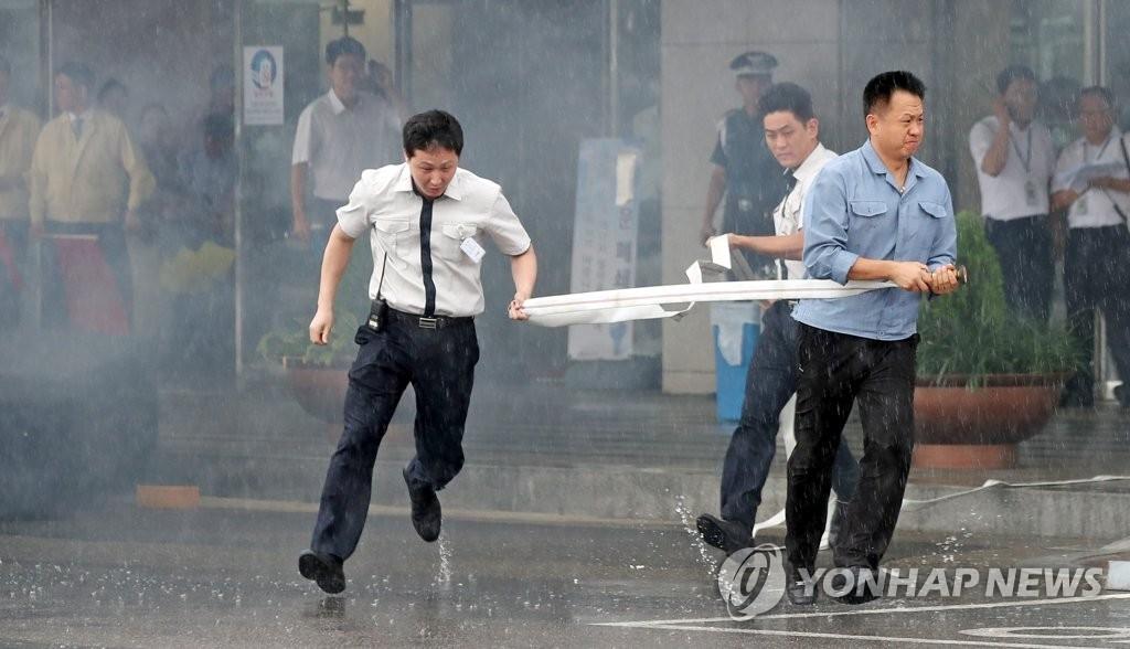 资料图片:灭火演习(韩联社)