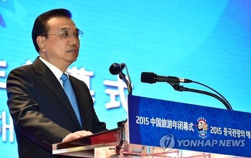 资料图片:中国国务院总理李克强(韩联社)