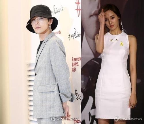 资料图片:D-RAGON和李珠妍(韩联社)