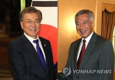 资料图片:韩国总统文在寅(左)与新加坡总理李显龙(韩联社/韩国国会议长室提供)