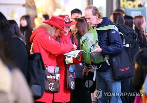 资料图片:首尔明洞街景(韩联社)