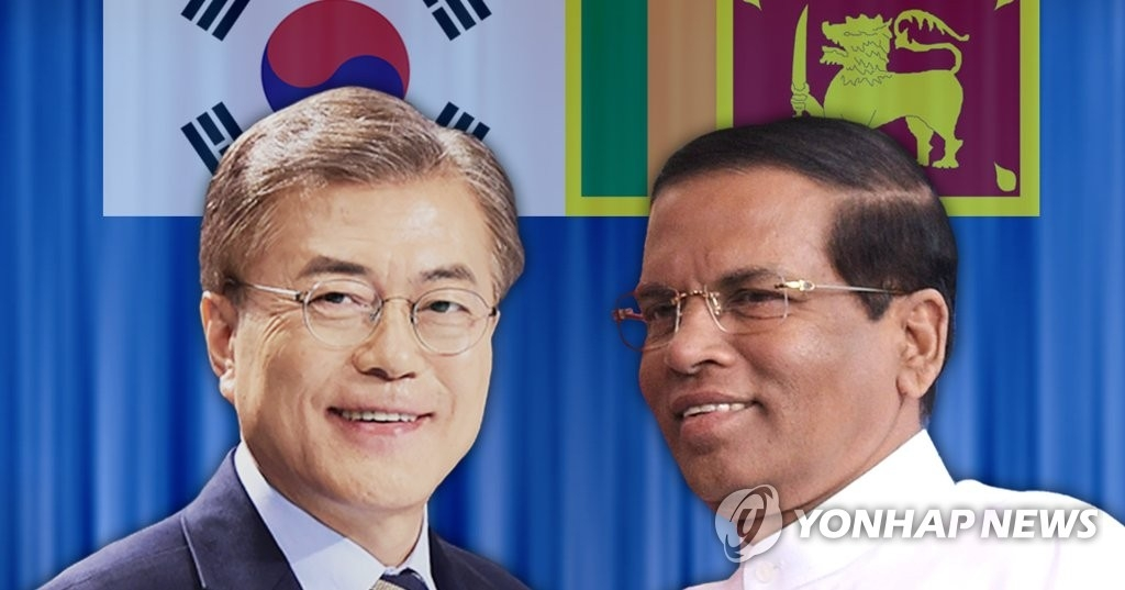 资料图片:左为文在寅,右为西里塞纳。(韩联社)