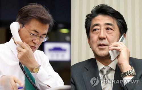 资料图片:韩国总统文在寅(左)与日本首相安倍晋三 (韩联社)