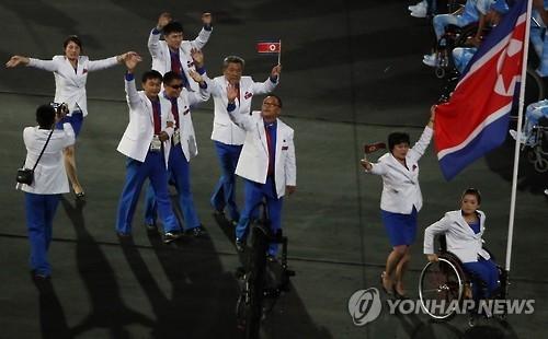 资料图片:朝鲜代表团亮相里约残奥会开幕式。(韩联社)