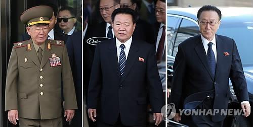 资料图片:图为2014年仁川亚运会在韩国举行时访韩的朝鲜高层人士,从左依次为黄炳誓、崔龙海、已故的金养建。(韩联社)