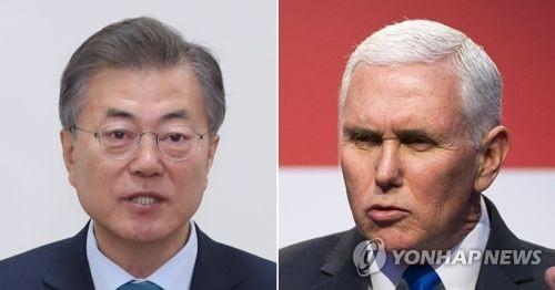 文在寅(左)和彭斯(韩联社)