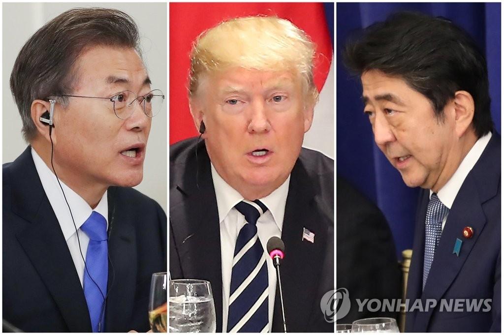 资料图片:2017年9月21日,韩美日领导人在纽约举行会议,从左依次是韩国总统文在寅、美国总统特朗普、日本首相安倍晋三。(韩联社)