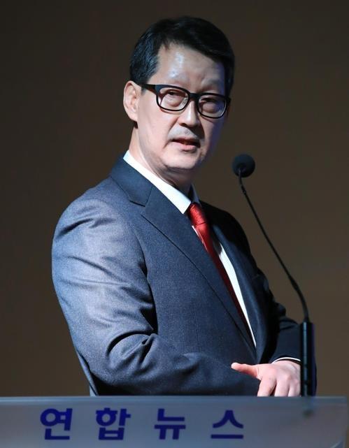 资料图片:赵成富(韩联社)