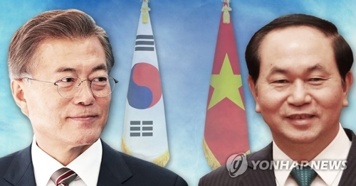 文在寅(左)和越南国家主席陈大光(韩联社)