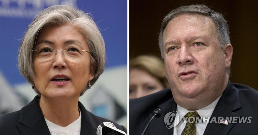 资料图片:左为韩国外长康京和,右为美国新任国务卿蓬佩奥。(韩联社/欧新社)