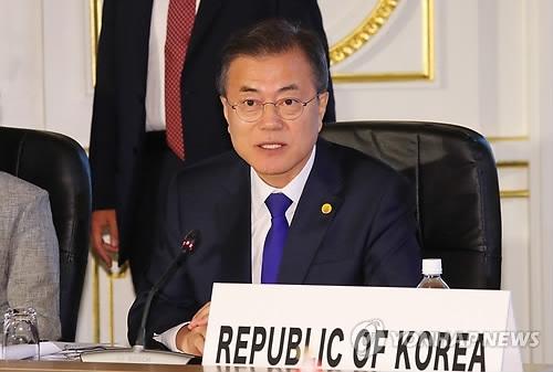 文在寅:韩中日齐心协力必将开创和平时代