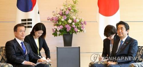 韩日首脑会晤商定加强无核化合作