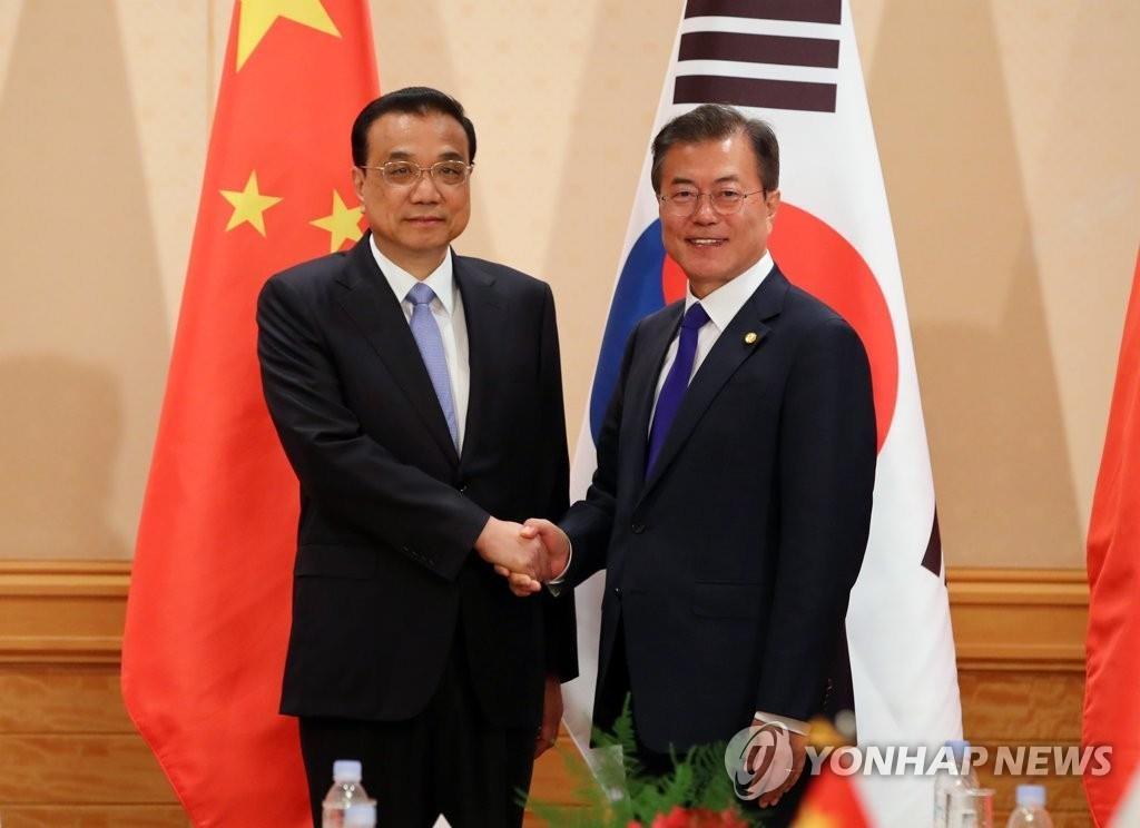 韩中领导人商定为半岛停转和保持紧密合作
