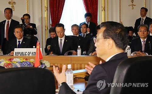 韩中日领导人会议现场(韩联社)