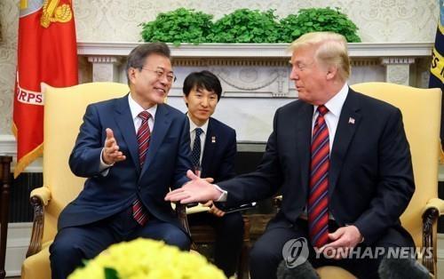 详讯:特朗普表示若朝鲜落实无核化就保障其体制安全