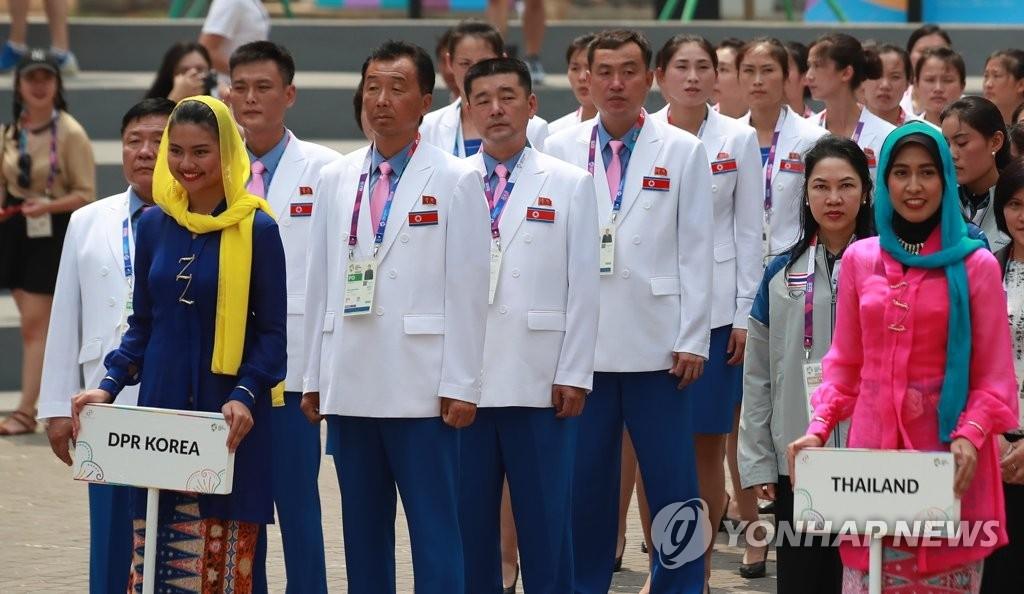 亚运会朝鲜代表团举行入村仪式