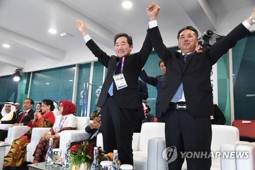 韩总理:主动牵手朝副总理欢迎韩朝共同入场