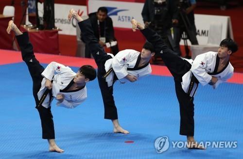 资料图片:8月19日,在雅加达国际会展中心,韩国队在比赛中。(韩联社)