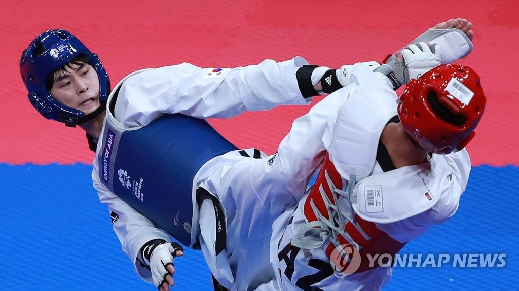 亚运男子跆拳道58公斤级韩国金泰勋夺金