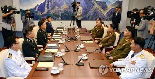 资料图片:2018年6月14日举行的第9次韩朝将军级会谈现场(韩联社)
