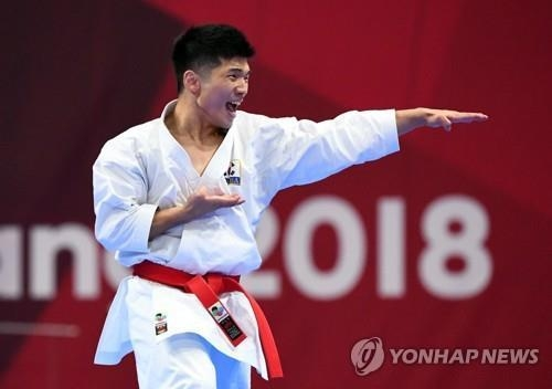 8月25日,韩国选手朴熙俊出战雅加达亚运会空手道男子三四名决赛。(韩联社)
