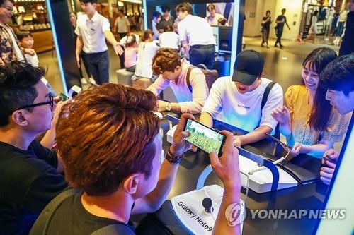调查:八成多韩国人担忧手机上瘾症