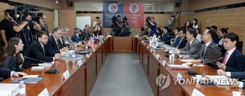 资料图片:韩美防卫费分担协定谈判现场(韩联社)