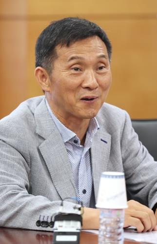 资料图片:金渊明(韩联社)