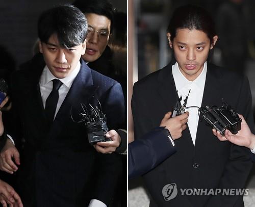 3月15日上午,在首尔地方警察厅,BIGBANG胜利和郑俊英接受一整夜的讯问后回家。(韩联社)