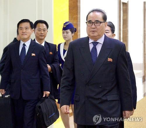 朝媒报道李洙墉启程访问老挝消息