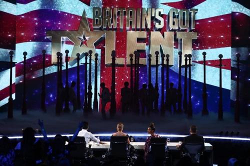 防弹少年团登《英国达人秀》舞台献唱新歌。(ITV1供图)