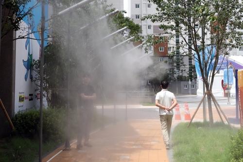 光州世游赛运动员村消暑喷雾设施 韩联社