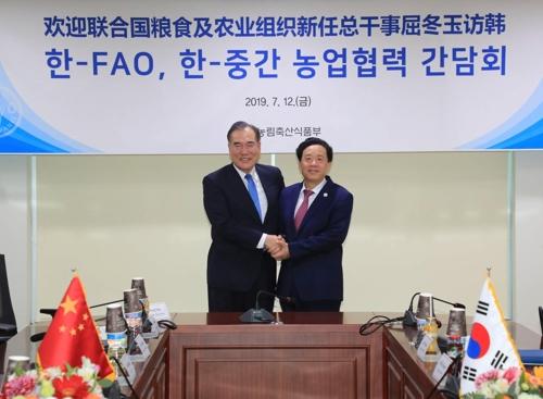 韩农林部长官会见粮农组织候任总干事屈冬玉